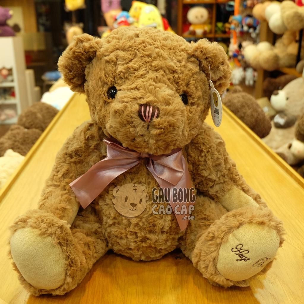Gấu Teddy lông xoắn Hugs Baby đeo nơ