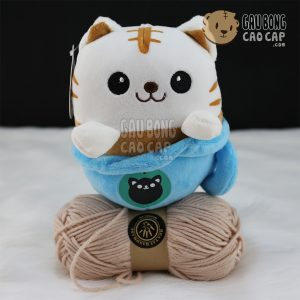 Mèo con ngồi trong Ly
