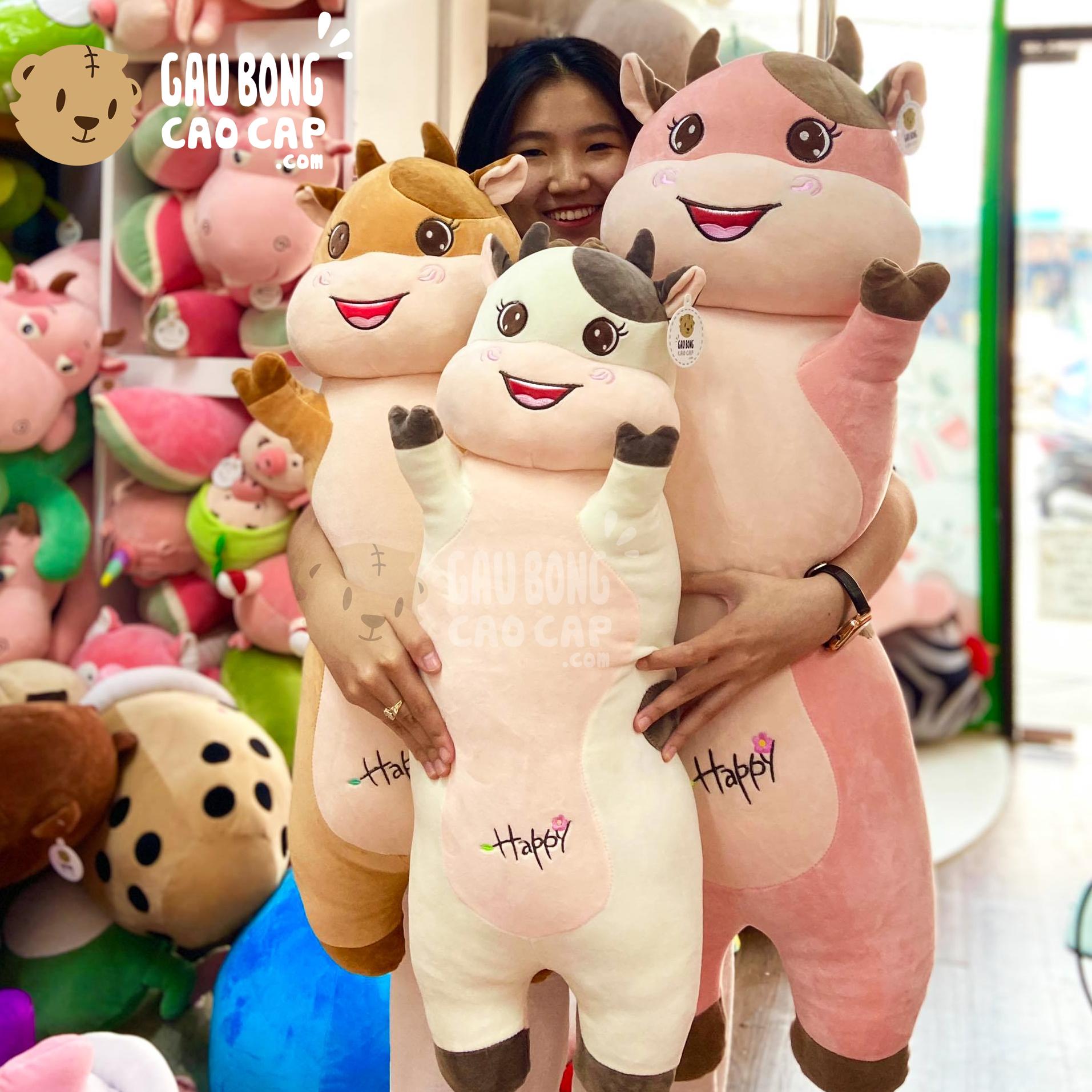 Gấu Bông Bò Sữa Happy gối ôm dài đứng giơ tay